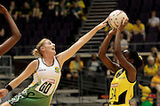 04.07.2011 Leigh Ann Zackey of South Africa(left) goes in for the block on Anna-Kay Griffiths during the Pool C match between Jamaica and South Africa, Mission Foods World Netball Championships 2011 from the Singapore Indoor Stadium in Singapore.