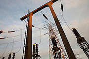 Insulator discs and pylon at the electricity substation, South Bromley, seen from the Pylon Industrial Estate, London.