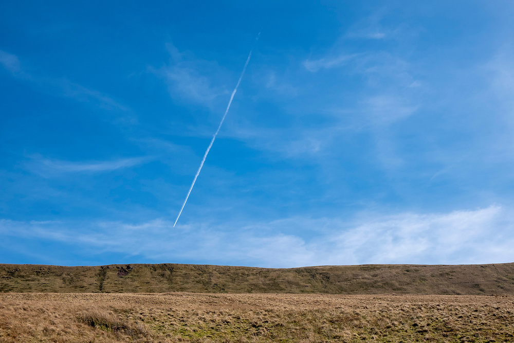A condensation plane trail across a blue sky above the Pen Y Fan mountainside in Brecon Beacons National Park, Wales, Powys, United Kingdom.   (photo by Andrew Aitchison / In pictures via Getty Images)