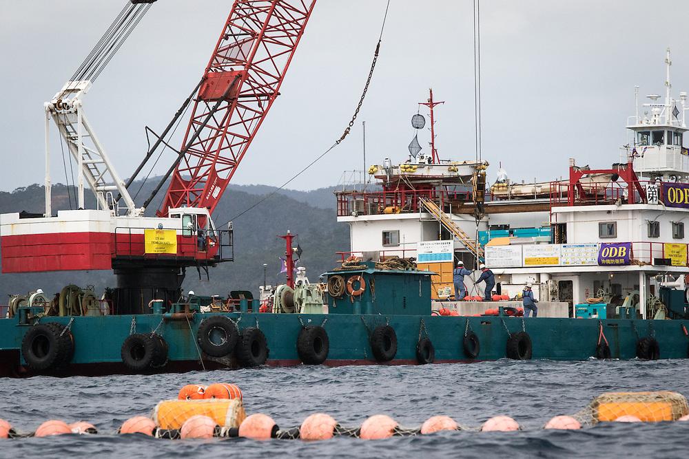 OKINAWA, JAPAN - FEBRUARY 7 :  Workers were seen dropping concrete blocks into the sea from barges off the new U.S Marine Airbase in Oura Bay, Henoko, Nago, Okinawa, Japan on Feb. 7, 2017. (Photo by Richard Atrero de Guzman/NURPhoto)