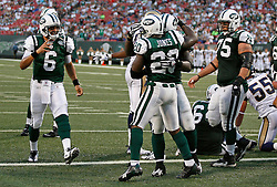 Aug 14, 2009; East Rutherford, NJ, USA;   New York Jets quarterback Mark Sanchez (6) runs to congratulate New York Jets running back Thomas Jones (20) after his touchdown during the first half at Giants Stadium.