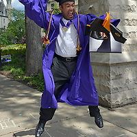 A Northwestern University student leaps high in the air celebrating his graduation form the Evanston school.