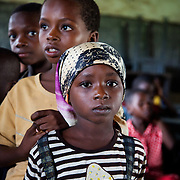 A small girl and her friends are queuing up to be HIV tested as part of EVA's EVA Youth World HCT session in rural Markurdi.  EVA provide HCT in three rural communities near Makurdi in Benue state. Benue state has got one of the highest HIV prevalence in Nigeria and EVA aim to target vulnerable children who would otherwise miss out of being tested for HIV and therefor not know their HIV statues.  Education As a Vaccine Against Aids (EVA) in Nigeria.