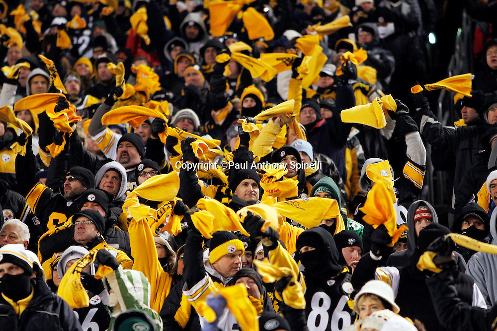 Pittsburgh Steelers fans wave terrible towels and cheer wildly after the Steelers win the NFL 2011 AFC Championship playoff football game against the New York Jets on Sunday, January 23, 2011 in Pittsburgh, Pennsylvania. The Steelers won the game 24-19. (©Paul Anthony Spinelli)