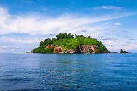 Riau Islands, Natuna Islands. Blue skies, a blue ocean and a tropical island. Southwest Natuna. Small island just north of Kalimantan, looking south.
