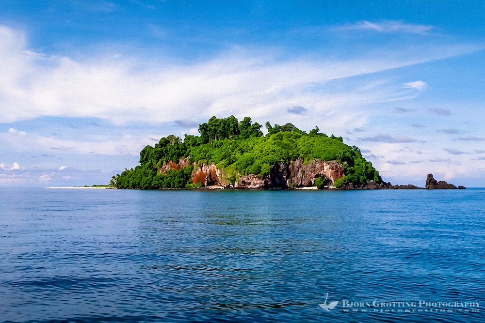 Riau Islands, Natuna Islands. Blue skies, a blue ocean and a tropical island. Southwest Natuna. Small island just north of Kalimantan, looking south.