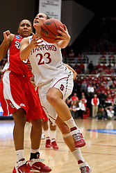March 21, 2011; Stanford, CA, USA; Stanford Cardinal guard Jeanette Pohlen (23) shoots past St. John's Red Storm forward Da'Shena Stevens (3) during the second half of the second round of the 2011 NCAA women's basketball tournament at Maples Pavilion. Stanford defeated St. John's 75-49.