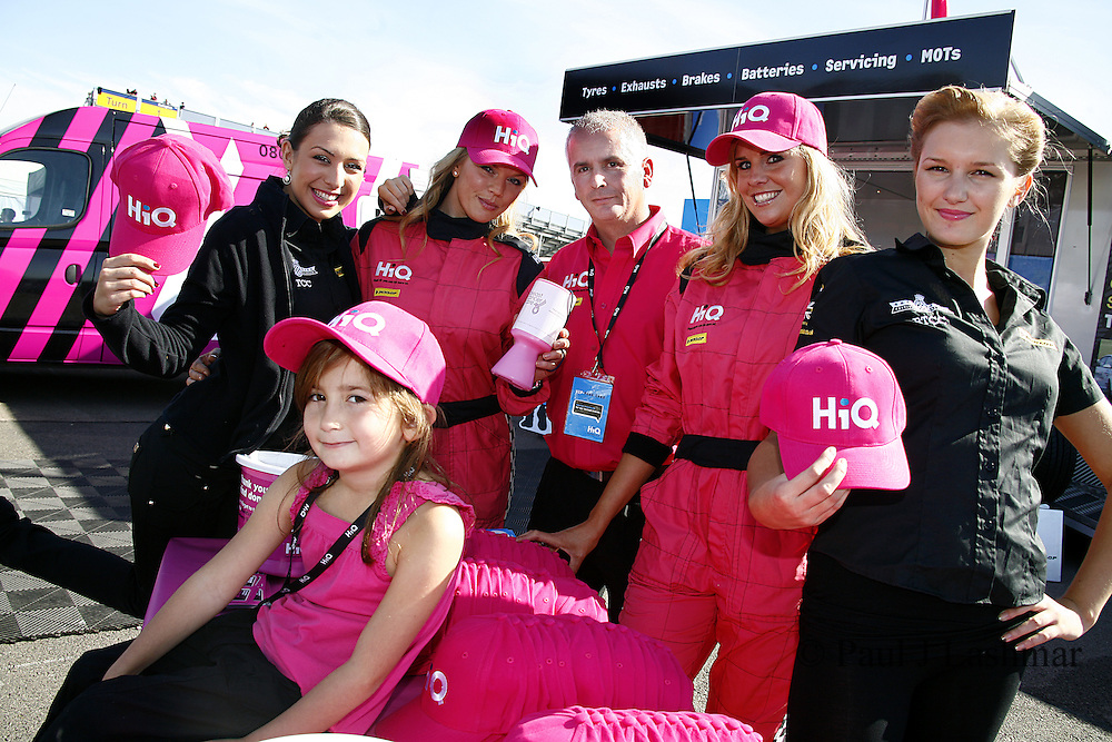 Pink Girls with HiQ Breast Cancer support hats with Hiq rushden's Paul Evans and his daughter, Demi.