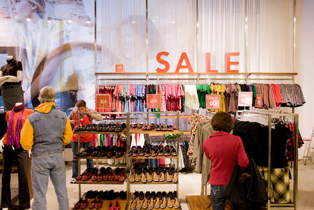 4 October, 2008. Customers check items on sale in the Ann Taylor-LOFT store in Times Square. As the financial crisis spread last month, many retailers hit the panic button, offering more generous discounts than they did at the same time last year. But the promotions did little to convince cautious shoppers to open their wallets.<br /> <br /> ©2008 Gianni Cipriano for The Wall Street Journal<br /> cell. +1 646 465 2168 (USA)<br /> cell. +1 328 567 7923 (Italy)<br /> gianni@giannicipriano.com<br /> www.giannicipriano.com