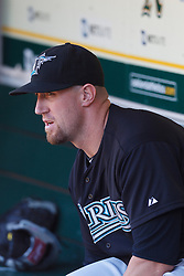 June 29, 2011; Oakland, CA, USA; Florida Marlins catcher John Buck (14) sits in the dugout before the game against the Oakland Athletics at the O.co Coliseum.  Florida defeated Oakland 3-0.