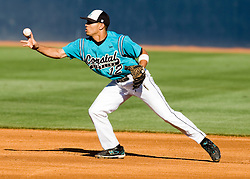 Coastal Carolina infielder Rico Noel (12) turns a double play against UVA.  The #24 ranked Virginia Cavaliers baseball team faced the Coastal Carolina Chanticleers at the University of Virginia's Davenport Field in Charlottesville, VA on April 15, 2008.
