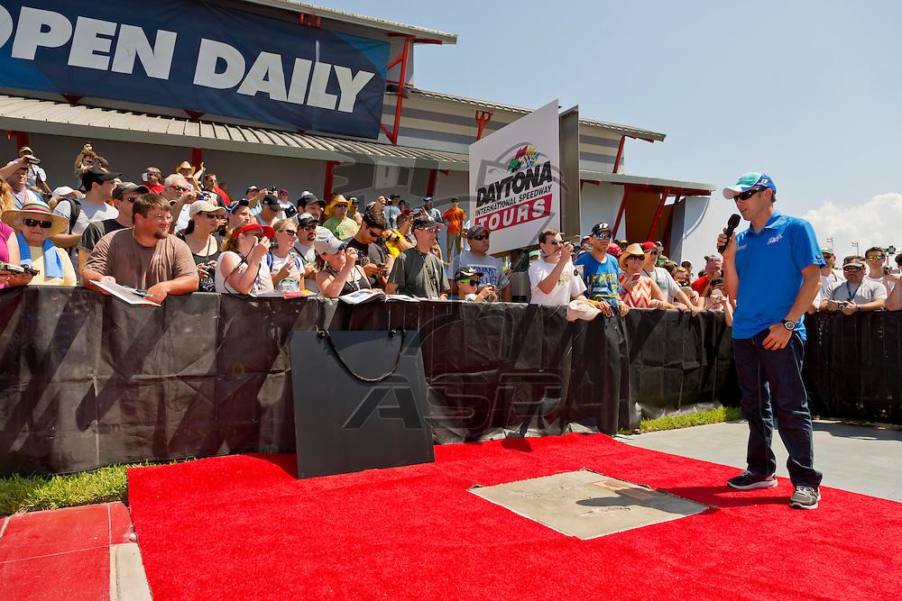 DAYTONA BEACH, FL - JUL 07, 2012:  Matt Kenseth (17) signs autographs and poses for photos as his footprints are unveiled at the Daytona Walk of Fame before the start of the Coke Zero 400 at the Daytona International Speedway in Daytona Beach, FL.