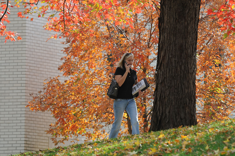 A student walks to class on a warm fall afternoon near Lowry Hall.