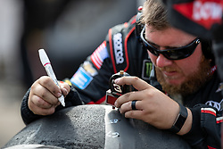 August 12, 2018 - Brooklyn, MI, U.S. - BROOKLYN, MI - AUGUST 12: A crew member for Monster Energy NASCAR Cup Series driver Austin Dillon (not pictured) uses a depth gage after a pit stop during the Monster Energy NASCAR Cup Series Consumers Energy 400 at Michigan International Speedway on August 12, 2018 in Brooklyn, Michigan.(Photo by Adam Lacy/Icon Sportswire) (Credit Image: © Adam Lacy/Icon SMI via ZUMA Press)