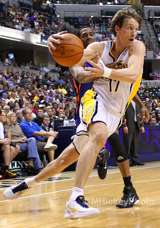 April 10, 2011; Indianapolis, IN, USA; Indiana Pacers forward Mike Dunleavy (17) dribbles around New York Knicks forward Derrick Brown (2) at Conseco Fieldhouse. Mandatory credit: Michael Hickey-US PRESSWIRE