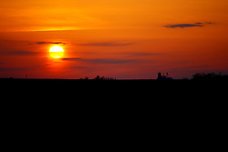 26 April 2008:  The grain elevator in the village of Holder Illinois is lit by the sinking sun in the late spring