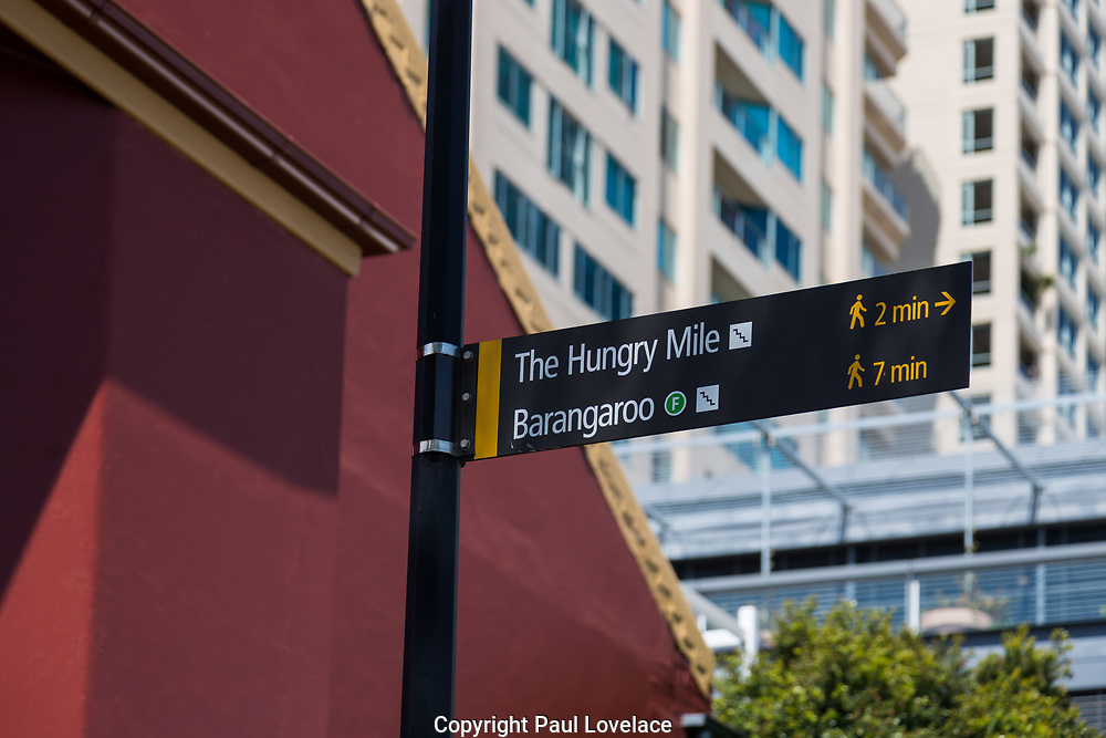 Signage outside a commercial office building along Barangaroo pedestrian walkway, Shipwright Walk, Sydney, Australia.