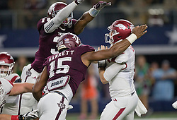 Texas A&M's defensive lineman Myles Garrett (15) pressure Arkansas' quarterback Austin Allen (8) during the first quarter of an NCAA college football game Saturday, Sept. 24, 2016, in Arlington, Texas. (The Eagle/Sam Craft)