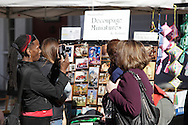 Sugar Loaf, New York - A woman takes a photograph of craft items for sale outside a store during the Sugar Loaf Fall Festival on Oct. 10, 2010. ©Tom Bushey / The Image Works