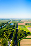Nederland, Flevoland, Almere, 07-05-2018; A6 met afslag Almere-Buiten Oost, N 702, Buitenring, landschapsontwerp van de beplanting.<br /> Landscape design of the planting, Eastern Flevoland.<br /> luchtfoto (toeslag op standard tarieven);<br /> aerial photo (additional fee required);<br /> copyright foto/photo Siebe Swart