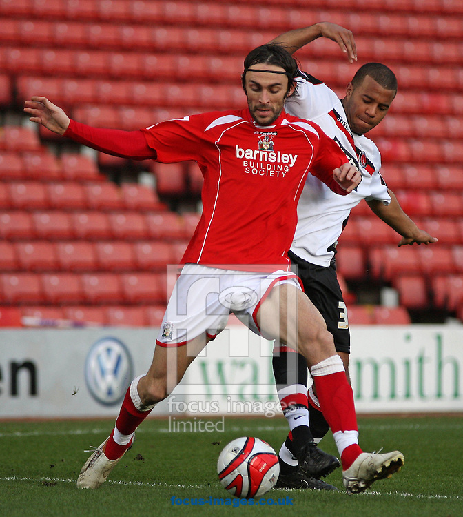 Barnsley - Saturday 21st February 2009 : Daniel Bogdanovic of Barnsley & Tom Soares  of Charlton Athletic in action during the Coca Cola Championship match at Oakwell, Barnsley. (Pic by Steven Price/Focus Images)