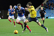 Carlisle United defender Michael Raynes tracks Oxford United striker Danny Hylton during the Sky Bet League 2 match between Oxford United and Carlisle United at the Kassam Stadium, Oxford, England on 12 December 2015. Photo by Alan Franklin.