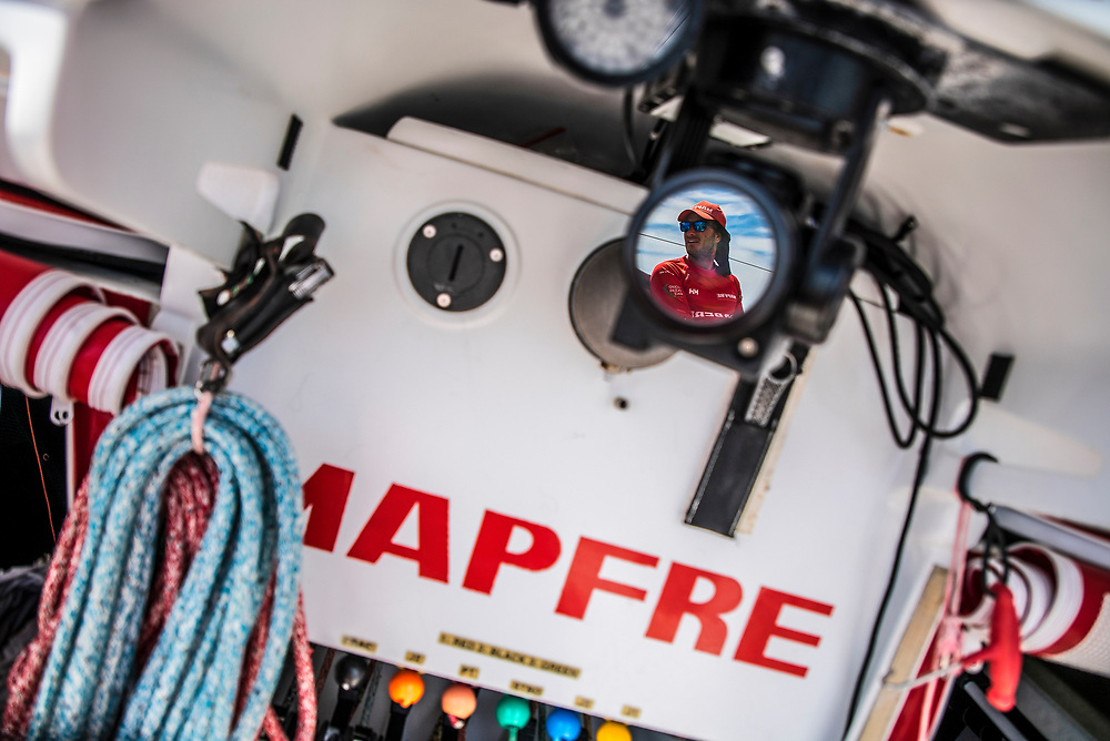 Leg 6 to Auckland, day 21 on board MAPFRE, Blair Tuke reflected in a lens of a on board camera. 27 February, 2018.