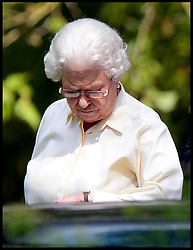 HM The Queen checks her watch as she watches the carriage driving at Windsor Horse Show. Windsor, United Kingdom. Saturday, 17th May 2014. Picture by Andrew Parsons / i-Images