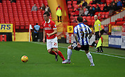 Charlton Athletic defender Morgan Fox setting up another Charlton attack during the Sky Bet Championship match between Charlton Athletic and Sheffield Wednesday at The Valley, London, England on 7 November 2015. Photo by Matthew Redman.