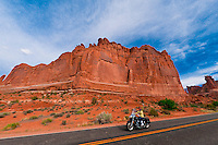 Women riding Harleys through Arches National Park, near Moab, Utah USA