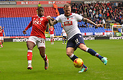 Bolton Defender, David Wheater wins the chase for the ball from Bristol city forward, Kieran Agard during the Sky Bet Championship match between Bolton Wanderers and Bristol City at the Macron Stadium, Bolton, England on 7 November 2015. Photo by Mark Pollitt.