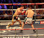 Picture by Richard Gould/Focus Images Ltd +44 7855 403186<br /> 13/07/2013<br /> Tommy Coyle (black &amp; gold)  and Derry Mathews fight for the vacant Commonwealth Lightweight title at Craven Park, Hull.