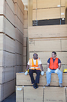 Men taking break from work in warehouse