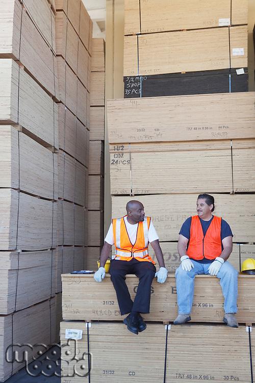 Men taking break from work in warehouse