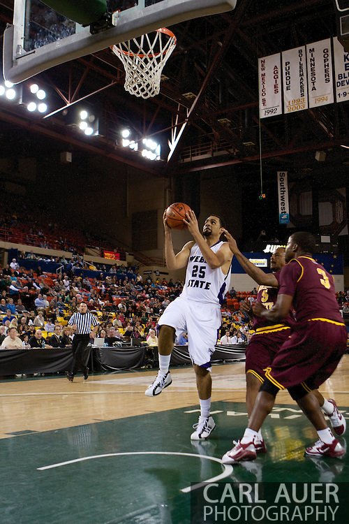 November 26th, 2010:  Anchorage, Alaska - Byron Fulton (25), a freshman forward for Weber State lifts off for a lay up in the Wildcats 58-59 loss to Arizona State at the Great Alaska Shootout.