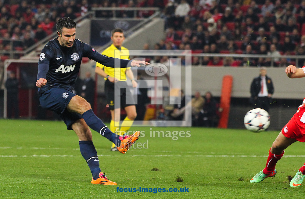 Robin van Persie (left) of Manchester United takes a shot during the UEFA Champions League match at Karaiskakis Stadium, Piraeus<br /> Picture by Tom Smith/Focus Images Ltd 07545141164<br /> 25/02/2014
