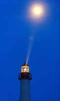 The Cape May Lighthouse photographed under a full moon, was built in 1859, is still an active aid to maritime navigation.