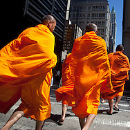 New York. group of buddhist monks walking on Broadway in  in  lower Manhattan / groupe de moines bouddhiste sur Broadway  sud de Manhattan