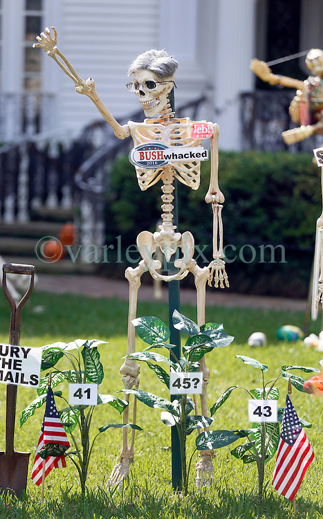 30 October 2015. New Orleans, Louisiana.<br /> The Skeleton Krewe mansion on St Charles Avenue at the corner of State Street draws crowds with its satirically spooky Halloween decorations. American politics comes under fire with skeletons depicting Presidential hopeful Jeb Bush as 'Bush Whacked.'<br /> Photo©; Charlie Varley/varleypix.com
