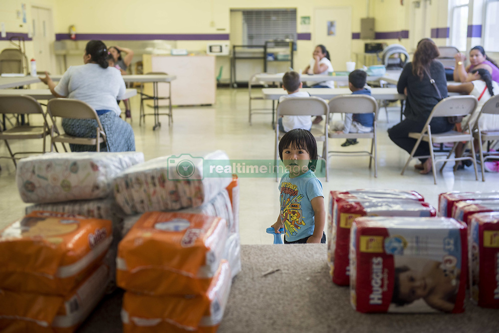 """May 20, 2017 - Lake Worth, Florida, U.S - Members of the Guatemalan community in Lake Worth, Fla. get together for diaper distribution for families in need and a """"know your rights"""" meeting. The event was organized by the Guatemalan Maya Center in Lake Worth and South Florida Activism in an effort to educate immigrants about their rights. (Credit Image: © Orit Ben-Ezzer via ZUMA Wire)"""