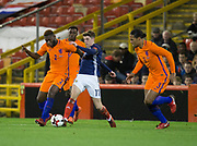 9th November 2017, Pittodrie Stadium, Aberdeen, Scotland; International Football Friendly, Scotland versus Netherlands; Scotland's Ryan Christie battles for the ball with Holland's Timothy Fosu-Mensah while Holland's Virgil van Dijk watches