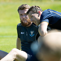St Johnstone Training…<br />Zander Clark and David McMillan pictured taking a breather during pre-season training at McDiarmid Park <br />Picture by Graeme Hart.<br />Copyright Perthshire Picture Agency<br />Tel: 01738 623350  Mobile: 07990 594431