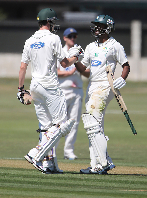 Central District's Tarun Nathula celebrates his maiden century in the Plunket Shield cricket match against Otago at Nelson Park, Napier, Zealand, Tuesday, November 27, 2012. Credit: SNPA / John Cowpland