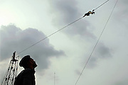 A recruit of the Shaheed Benazir Bhutto Elite Police Training Center, a commando and anti-terrorism academy on the outskirts of Karachi, is exercising on a high rope structure located on the premises. The training center was founded by retired colonel Abdul Wahid Khan, a brave officer who served as a gunship helicopter pilot in the Pakistani Air Force and around the globe with the United Nations, but who's first task as a young army officer in 1979 was to train Afghan Mujahedeen to fight the Soviet Army, the very Mujahedeen that are today's Taleban.