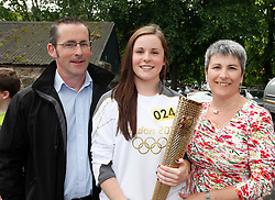 No fee for Repro: 06/06/2012.Sports Management and Coaching Student at ITB (Institute of Technology Blanchardstown) and Irish International Women's Soccer player Niamh Reid Burke of Raheny United is pictured with her parents as she prepairs to take part in historic Olympic Torch Relay through Dublin. Pic Andres Poveda.