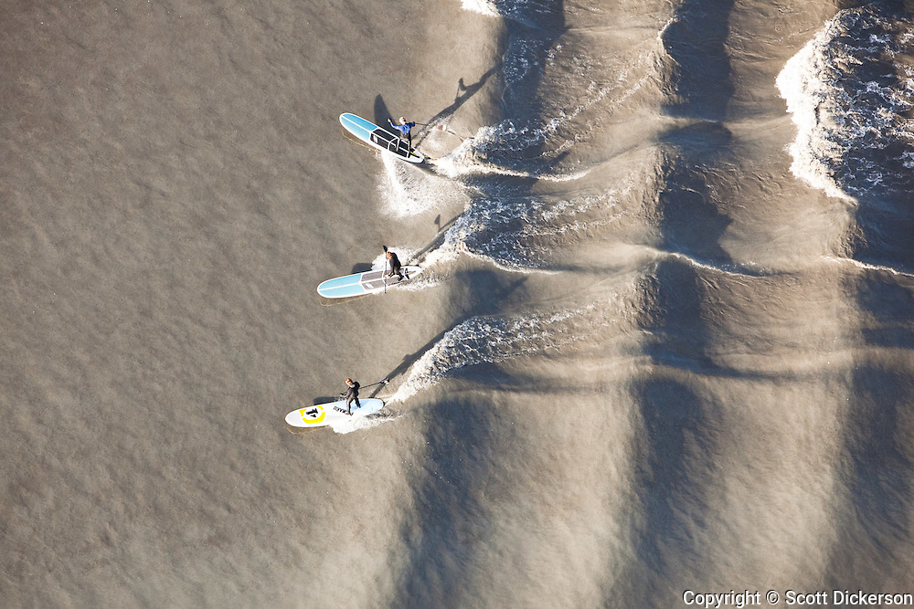 Aerial view of stand up paddle surfing the Turagain Arm boretide in Alaska. Photos by Scott Dickerson / www.SurfAlaska.net