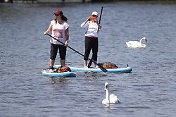 © Licensed to London News Pictures. 30/05/2020. Windsor, UK. Paddle boarders on the River Thames at Windsor enjoy the sunshine. The government have announced new measures from Monday to allow groups of six people to meet outdoors. Photo credit: Peter Macdiarmid/LNP