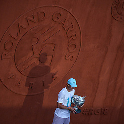 Rafael Nadal of Spain celebrates with the Musketeers cup during Day 15 for the French Open 2018 on June 10, 2018 in Paris, France. (Photo by Baptiste Fernandez/Icon Sport)