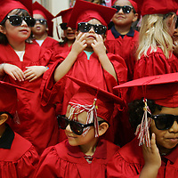 Crystal Chatham/The Desert Sun<br /> <br /> 06/07/2008 -- Members of the La Quinta YMCA preschool class of 2008 gather on stage wearing sunglasses before singing &quot;Three Little Pigs&quot; on Saturday, June 7 at the YMCA in Palm Desert. Family YMCA of the Desert held three commencement ceremonies Saturday to recognize graduates from their preschools in La Quinta, Palm Springs, and Indio.