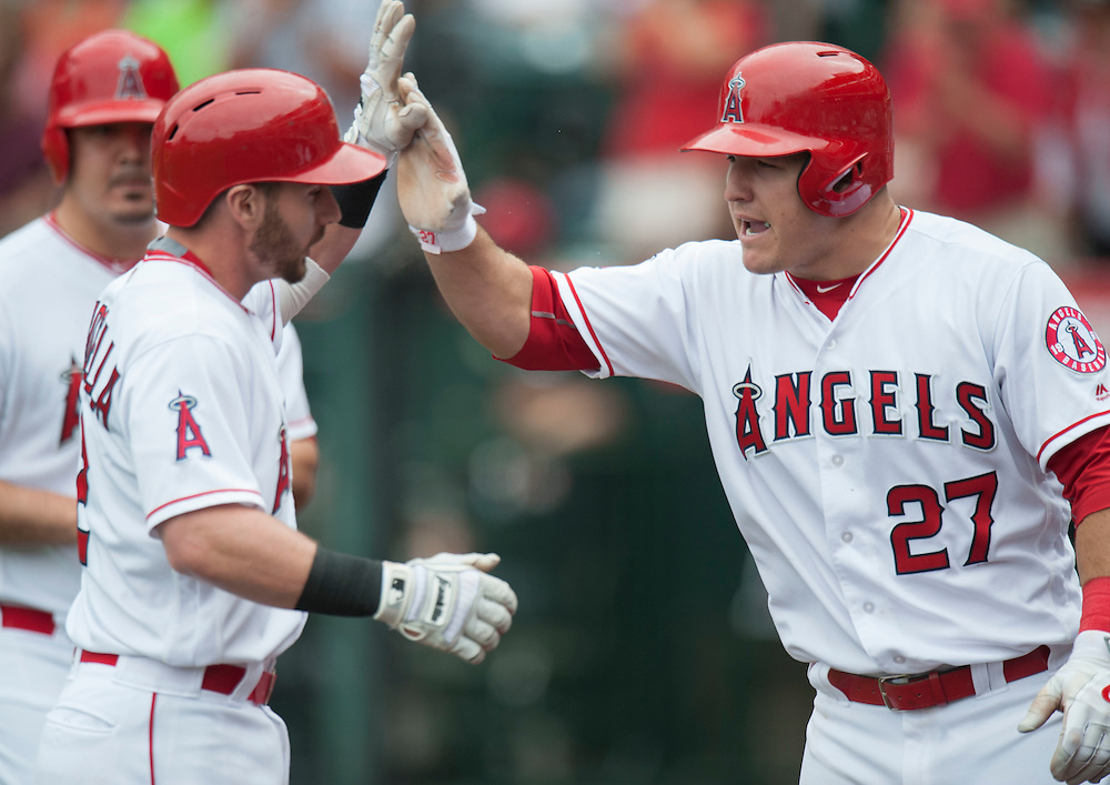 The Angels' Mike Trout celebrates after scoring on Johnny Giavotella's sacrifice in the seventh inning during the Angels' 13-inning 8-6 loss to the Houston Astros Sunday at Angel Stadium. <br /> <br />  //ADDITIONAL INFO:   <br /> <br /> angels.0530.kjs  ---  Photo by KEVIN SULLIVAN / Orange County Register  -- 5/29/16<br /> <br /> The Los Angeles Angels take on the Houston Astros Sunday at Angel Stadium.
